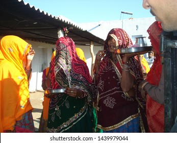 Nawalgarh, Rajasthan / India - January 21, 2013: Mangal songs are sung in the rural areas of Rajasthan on auspicious occasions. Some women singing Mangal Song.