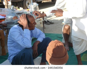 Nawalgarh, Rajasthan / India - January 21, 2013:There is a custom of tilak on good occasions in India. Some people are being tilak on the auspicious occasion.