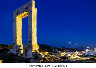 Naxos, Greece - June 10th 2015: View of Naxos town with the Ancient gate illuminated.