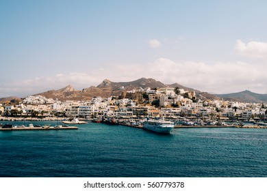 Naxos, Greece - September 13, 2016 - Picture taken from ferry arriving at the island of Naxos in Cyclades. Naxos town with its dramatic mountains scenery behind it.