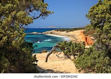 "NAXOS ISLAND, CYCLADES, AEGEAN SEA, GREECE. ""Passage"" to Alyko beach, at Kedrodasos (literally ""Cedar forest"")"