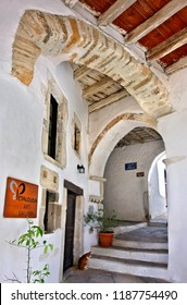 """NAXOS ISLAND, CYCLADES, AEGEAN SEA, GREECE- May 2, 2012. Beautiful """"stiasto"""" or """"steasto"""" (arched gallery) close to one of the gates of the castle of Sanoudos, in Chora, the capital town of the island"""
