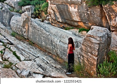"""NAXOS ISLAND, CYCLADES, AEGEAN SEA, GREECE- May 5, 2012. The archaic, gigantic and incomplete statue (almost 10 meters long), known as """"Kouros"""", close to Apollonas village."""