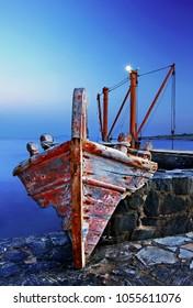 """NAXOS ISLAND, CYCLADES, GREECE- May 3, 2012. Night falling at Moutsouna, """"seaport"""" of Apiranthos village."""