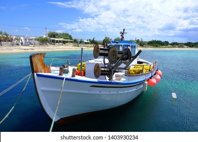 Naxos island, Cyclades / Greece - May 19 2019: Photo of traditional fishing boat in picturesque island of Naxos, Cyclades, Greece