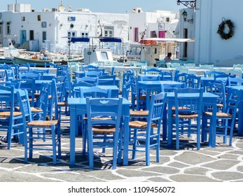Naxos Island, Greece: August 05. 2009: Resturant with blue tables and chairs in traditional Greek tavern waiting for customers in high season on Naxos island, Greece.