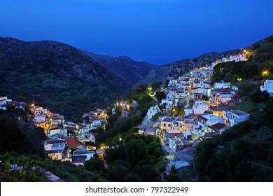 NAXOS ISLAND, GREECE. Night view of Koronos village, one of the most beautiful mountainous villages of Naxos island, Cyclades.