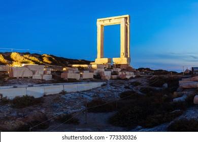 Naxos Portara or Apollo Temple entrance gate on Palatia island near Naxos island in Greece at night