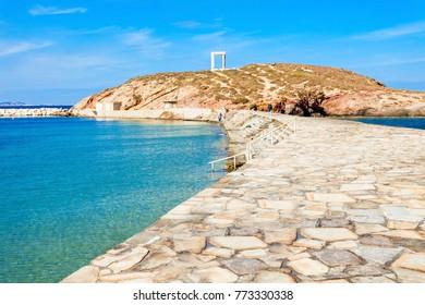 Naxos Portara or Apollo Temple entrance gate on Palatia island near Naxos island in Greece