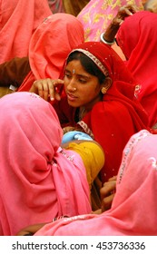 NAYLA FORT, INDIA - MARCH 10, 2006: Young woman talking to a group of elders at a meeting of farmers in Nayla Fort near Jaipur