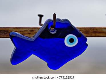 Nazar eye-shaped amulet believed to protect against the evil eye. blue glass fish