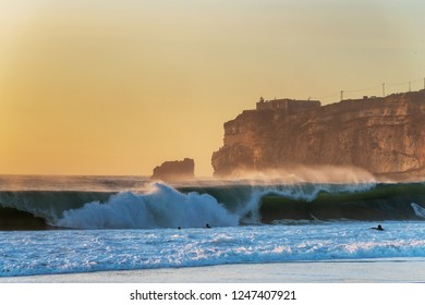 Nazare cliff in sunset time, Portugal.