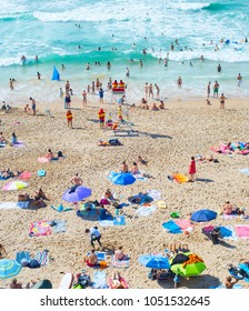 NAZARE, PORTUGAL - AUG 11, 2017: People at the ocean beach. Portugal is a famous tourist destination for the beautful ocean beaches.