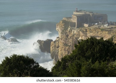 NAZARE, PORTUGAL - Dec 17,  2016: Spectators on and around the lighthouse at the Praia do Norte in Nazare, Portugal to see huge XXL waves.