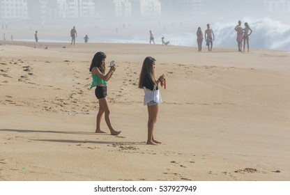 NAZARE, PORTUGAL - OCTOBER 20, 2014: On the beach of the Portuguese town of Nazare warm autumn day in October 2014