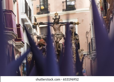 Nazarenos carrying sculpture of crucified Jesus Christ during Easter procession at Sevilla, Spain.