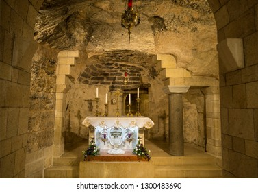"""NAZARETH, ISRAEL - DECEMBER 06, 2015:The interior of the grotto of the Annunciation Basilica in Nazareth, the Latin inscription reads: """"Here the Word became flesh"""", Israel"""