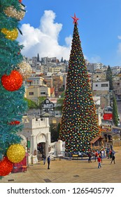 NAZARETH, ISRAEL - DECEMBER 23: People celebrate the Christmas, near the Greek Orthodox Church of the Annunciation in Nazareth, Israel, december 21, 2018