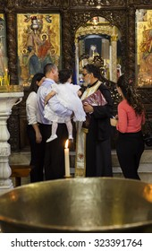 NAZARETH. ISRAEL - OCTOBER 25, 2014: Child baptism in Greek Orthodox Basilica of the Annunciation.