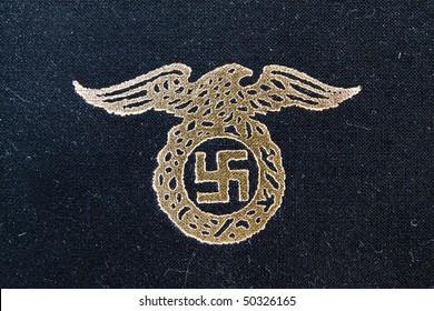 nazi eagle badge on book
