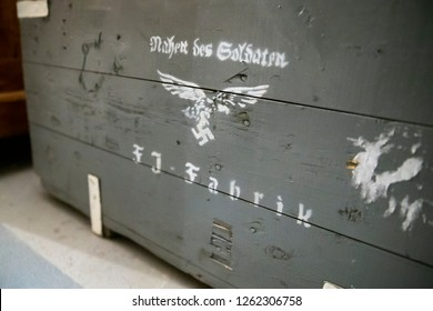 Nazi insignia on top of an ammunition crate - Image