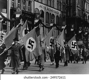 Nazis parade in Vienna, Austria, on May Day, 1938. The Anschluss with Nazi Germany violated of the Treaty of Versailles. Britain made 'grave warnings' but took no military action.