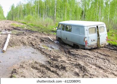 Naziya, Leningradskaya oblast, Russia - May 15, 2010:Car stuck in the muddy forest road