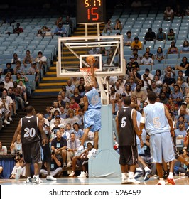 NBA star Vince Carter of the New Jersey Nets dunking in a charity basketball game