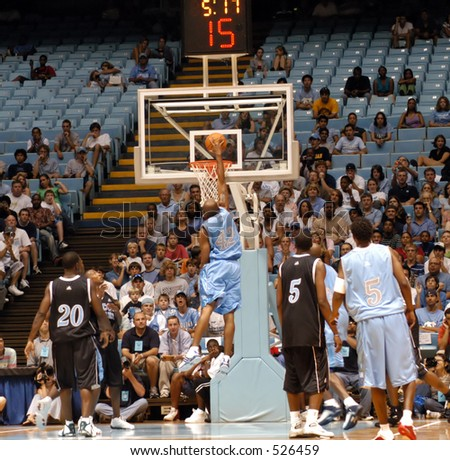 a488cc6032ec NBA star Vince Carter of the New Jersey Nets dunking in a charity basketball  game