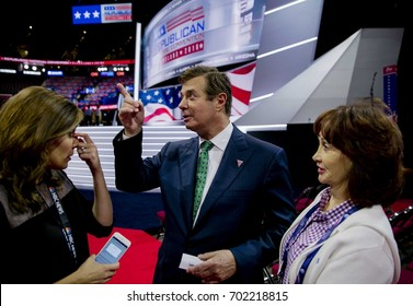 NBC's Hallie Jackson talking with Paul Manafort Donald Trump's campaign manager on the floor of the Quicken Arena trying to set up on camera interviews. Kathleen Manafort in the white outfit on right