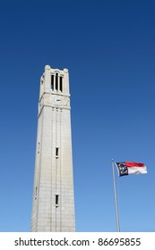 NC State University Bell Tower with flag in Raleigh, NC