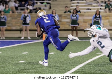NCAA Football Tulane vs Tulsa, Tulsa, USA -27 Oct 2018: Tulsa wide receiver (2) Keylon Strokes catches pass for touchdown during game between Tulane Uni. Green Tide and Uni. of Tulsa Golden Hurricane.
