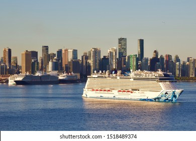 NCL Norwegian Bliss anchored in Vancover harbour, no room to dock at the crowded Canada Place pier.  Vancouver, BC/Canada/September 30th 2019