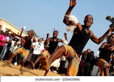 NDalatando, Angola - 2012: Young men dancing traditional african dance