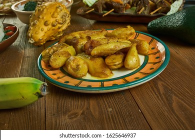 Ndizi Kaanga, grilled plantains or green bananas, Tanzanian cuisine, Traditional assorted African dishes, Top view.