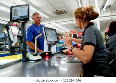 Nea Moudania, Greece, August 09, 2018:  Interior of a Lidl supermarket, Lidl is a German discount chain supermarket,  Customer in front of cash register,  standing in supermarket shop near cashier