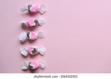 Neapolitan  flavored saltwater taffy  frames pink copy space.