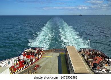 NEAR DOVER, UNITED KINGDOM - JULY 7, 2019: Deck of the ferry traveling the canal from Dunkirk, France, to Dover, United Kingdom. Air pollution is visible above a French industrial area.