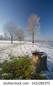 Near a lake in winter with a bit of snow and clear blue sky. Auesee in Wesel, Germany
