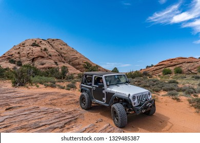 Near Moab, Utah, USA - 5/26/17 A modified Jeep Wrangler on sandstone