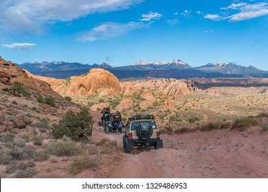 Near Moab, Utah, USA - 5/26/17 A modified Jeep Cherokee on sandstone