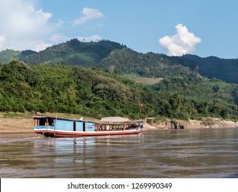 near pakbeng, laos - november 18, 2018: boat on the mekong