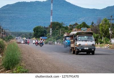 near pakse, laos - november 23, 2018: traffic on the road.