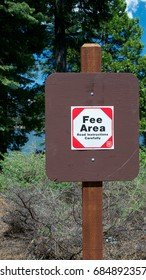 Near Pollock Pines, California, USA, 28 May 2017. US Forest sign indicating a fee area. Dams and lakes on Ice House Road, Eldorado National Forest, are now subjected day use fee.