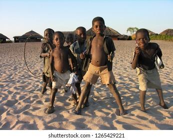 Near Pweto, Katanga, Democratic Republic of Congo, 12th June 2005: Children posing for the camera near the shore of Lake Mweru