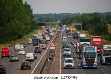 NEAR SALFORD, ENGLAND, UK - July 4, 2018: Heavy traffic on the M1 motorway near Salford Bedfordshire England UK