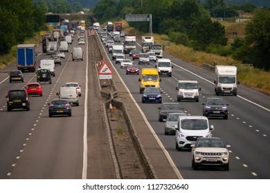NEAR SALFORD, ENGLAND, UK - July 4, 2018: Heavy traffic on the M1 motorway near Salford Bedfordshire England UK
