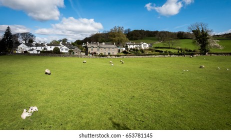 Near Sawrey, Cumbria, England. A sunny springtime view of the small Cumbrian village of Near Sawrey in the English Lake District.  The village was the home of children's author Beatrix Potter.