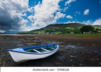 Near small town in isle of skye, Scotland, a small boat lied on empty river