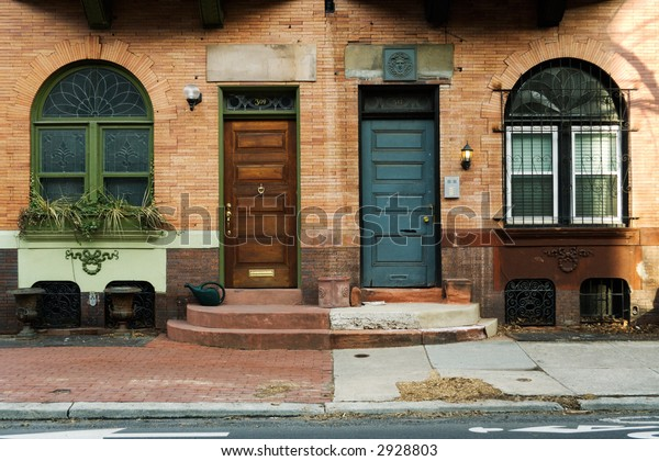 Near symmetry between two front doors, side by side.  Philadelphia, PA.